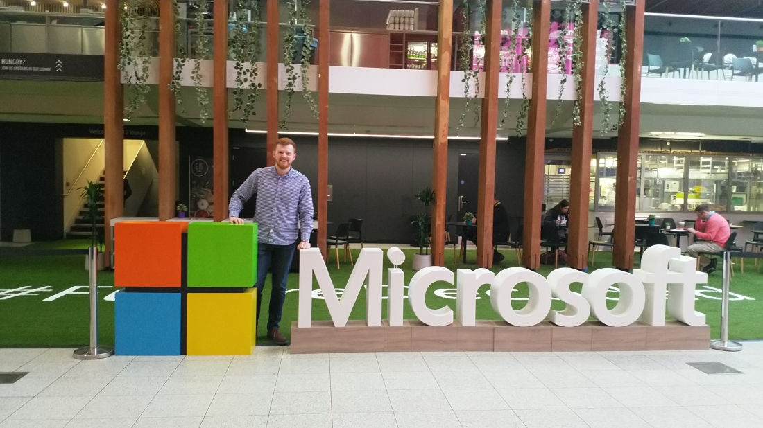Matthew Champion standing behind the Microsoft logo at Future Decoded 2018
