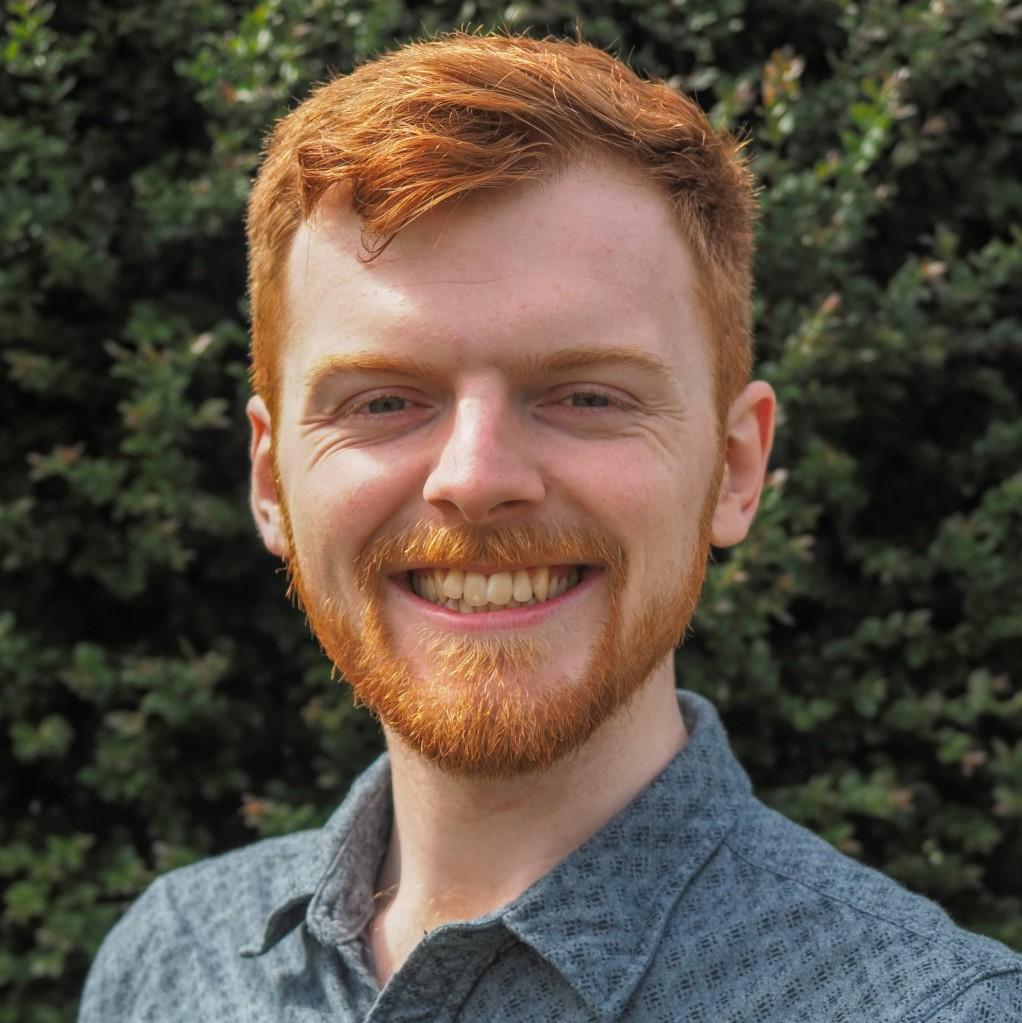 A headshot of Matthew Champion
