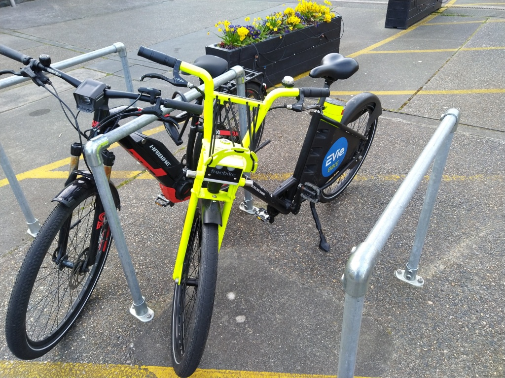 An EVieBike branded electric bike parked at the bike racks outside M and S in St Martin, Guernsey