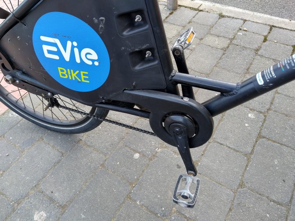 A closeup of the drivetrain and livery on an EVieBike branded electric bike
